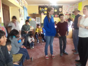 Taylor Family working with children in the library Yamparáez