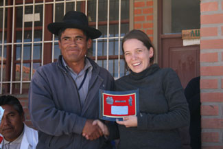 Latin America Project Coordinator with the recognition plaque given to her by the Yamaparaez mayor.