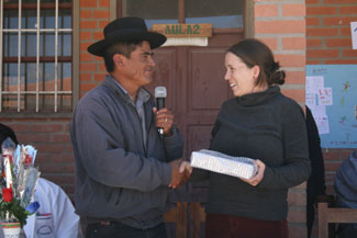 Yamparaez mayor, Anastacio Tango, presenting Latin America Project Coordinator, Megan Sherar, with a small gift at the 1-year anniversary of the library.