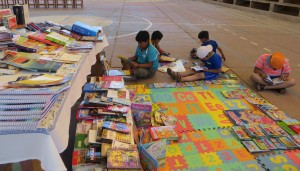 Local children delighting in their new books!